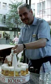 "A Cologne waiter, ""Koebes"" at work."